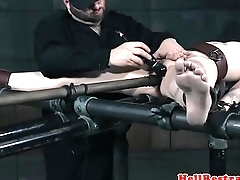 Butch submissive chastised with caning
